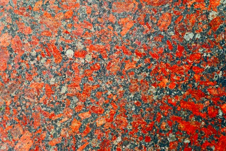nuances: Red and gray granite background with beautiful nuances. High Polished Red Granite Texture. Red Base with Black and Gray Spots. Close up of a polished red marbled granite texture