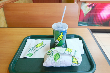 lunch tray: Astrakhan, Russia - circa 2015: Subway lunch with sandwich on the tray - illustrative editorial.