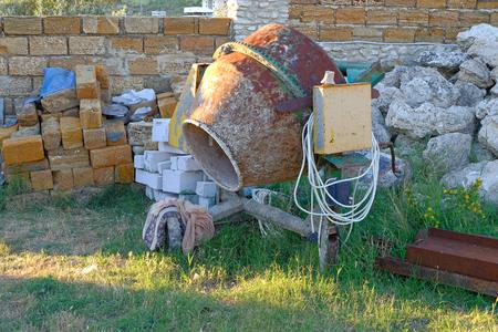 worn: Worn concrete mixer on working site