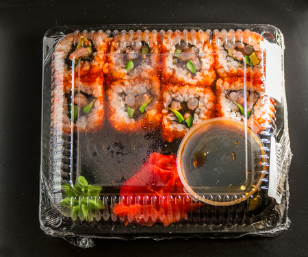 susi: Sushi in the package on a black background.