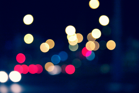 colorized: Defocused Blurred Shot of Traffic Lights Night Time bokeh Colorized Image.