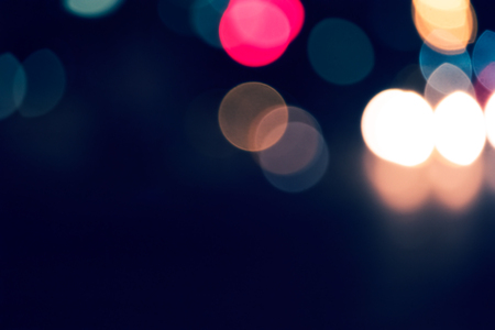 colorized: Out of focus lights of traffic in the street at nighttime colorized, a lot of space for text. Stock Photo