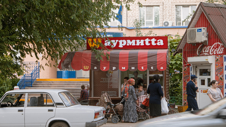 bogus: Astrakhan, Russia, May 24, 2016: Brand mimicry example. Local fast food using turned well known M of McDonalds in brand name. McDonalds is the worlds largest chain of fast food restaurants.