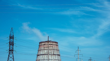 colorized: Smoking chimneys against the blue colorized sky.
