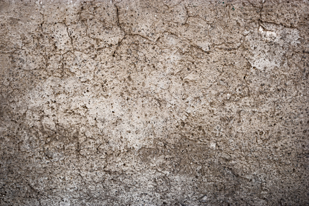 Cracked plaster on wall urban grungy background