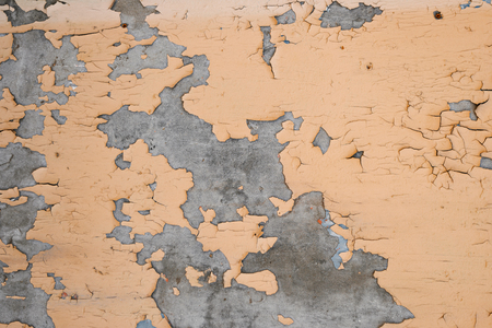 skimming: Old painted wall has rough spots and need cleaning before repair. Weathered urban background. Stock Photo