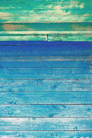 barndoor: Azure paint on old barndoor. The old blue wooden texture natural patterns of wood vertical orientation