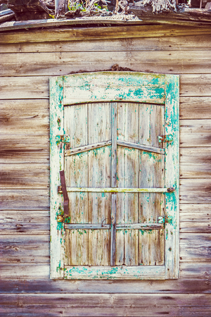 Weathered Wooden Window of old Russian Slum House in Astrakhan Russia.