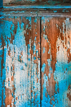 Old painted wood wall texture or can be used as background. Paint Peeling Off Surface. Stock Photo