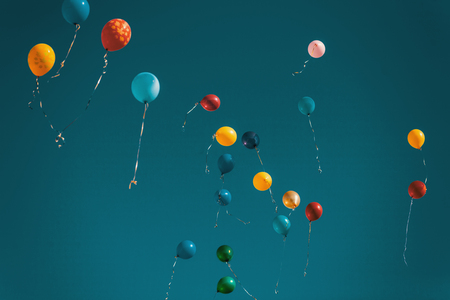 Colorful Balloons Flying Out In Blue Sky Vintage Colorized Image Stock Photo