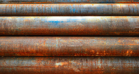 Background Of Rusty Pipes In Stack