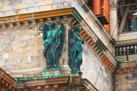 Saint Petersburg, Russia - Feb. 26, 2016: Two Angels on facade of Saint Isaacs Cathedral Detail.