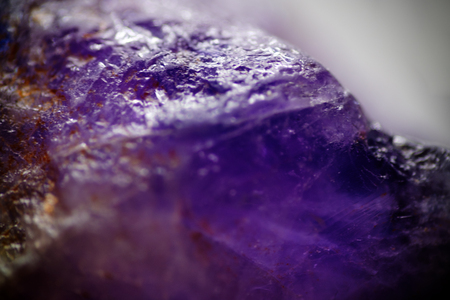 Closeup of natural raw amethyst. Violet chakra cristall for alternative healing Foto de archivo