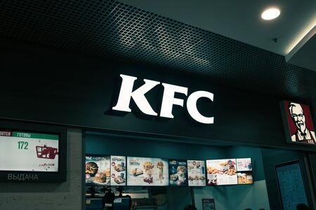 Astrakhan Russia 13 Feb. 2019: KFC fast food restaurant logo in food-court of mall. Kentucky Fried Chicken (KFC) is the worlds second largest restaurant chain with almost 20,000 locations globally.