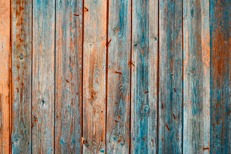 Fence planks. Weathered hardwood with signs of aging and bended over surface rusty nails