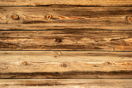 Wood Background Texture. Old Dark rough wood floor or surface with splinters and knots.