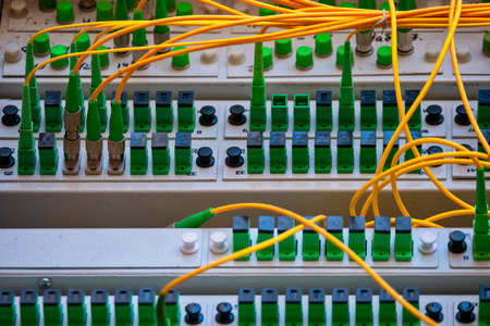 Fiber optic Patch Panel Open With Some Patch Cords Connected