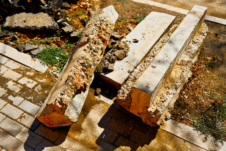 Demounted damaged concrete curbs on road side, debris from road repair Stockfoto - 122837339