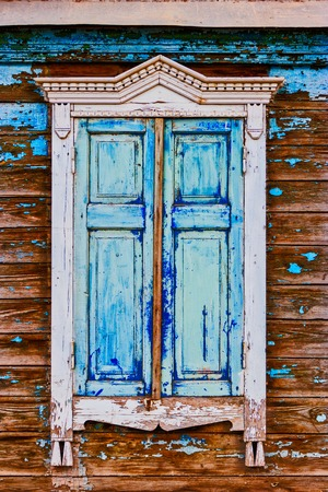 Carved Wooden Window With Blue Peeling Painnt