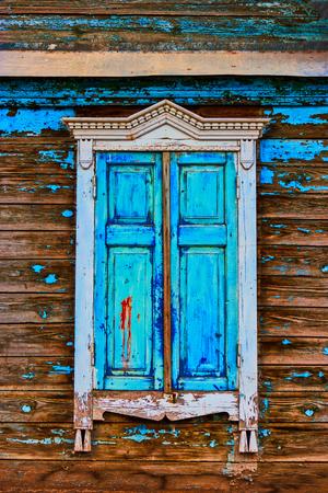 Obsolete window painted in worn sky blue color Stok Fotoğraf