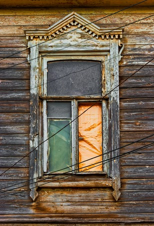 Worn wooden window in slums