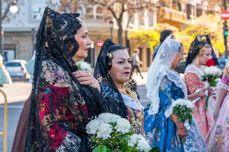 Valencia, Spain, March 18, 2019. Valencian Festival of Fallas. Festive procession in the center of the city. Women Falleras of Valencia.