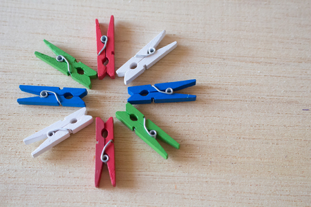 clothespins: Eight colorful of clothespins on wooden background Stock Photo