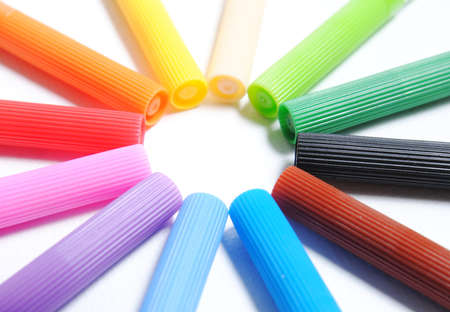 Colorful pens isolated on white background