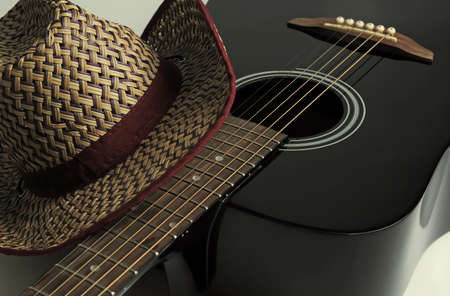 acoustic guitar and hat close-up, country music concept