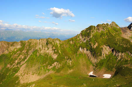 mountains with green grass and blue sky
