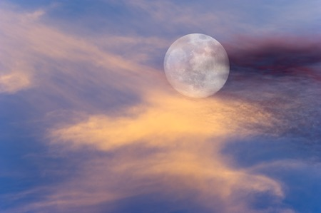 clouds and skies: Moon clouds skies is a vibrant surreal scenic of a full moon rising amongst the colorful cloudscape.