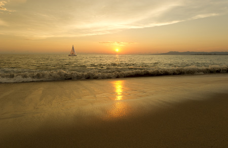 sailboat: Sailboat sunset is a sailboat moving across the water while the the sun sets on the ocean horizon