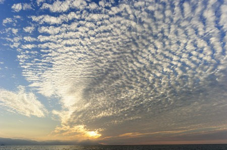 cloudscape: Clouds is a surreal cloudscape sky fuilled with patterned cumulus clouds. Stock Photo