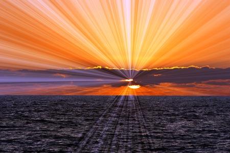 sun light: over the ocean horizon.