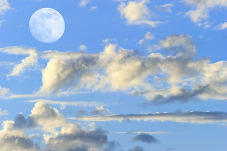 colorful cloudscape: Moon clouds skies is a vibrant surreal fantasy like cloudscape with the ethereal heavenly full moon rising among the vibrant wispy colorful cloudscape.