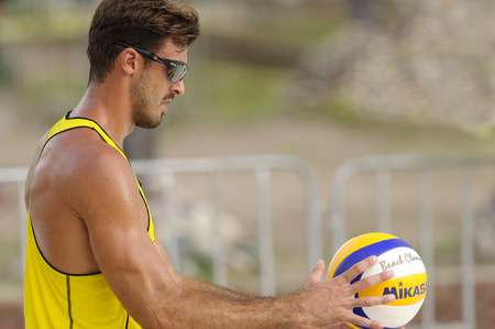 PUERTO, VALLARTA, JALISCO, MEXICO - October 9 - 2015 An professional beach volleyball player from the Italians men team is getting ready to serve the ball in tournament play.