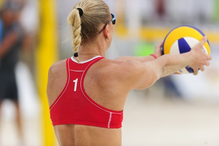 volley ball: Volleyball player is a female athlete volley ball player getting ready to serve the ball.