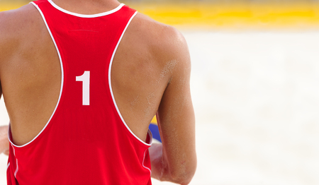 pelota de voley: Volleyball player is a male athlete volley ball player getting ready to serve the ball.