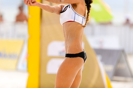 Volleyball player is a female beach volleyball player getting ready to set the ball. Stock Photo