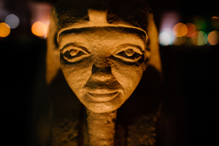 Egyptian pharaoh statue is a closeup head shot of a small Egyptian statue.