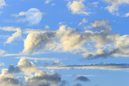 Moon clouds is a colorful surreal fantasy like pink and blue cloudscape with a magical surreal full moon rising in the night sky. Фото со стока