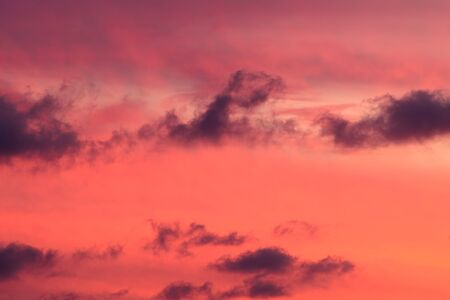 A Sunset Sky is Filled with Colorful Detailed Evening Clouds Фото со стока