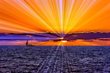 A Beautiful Sunset With a Boat Sailing along the Ocean Water and Sun Rats Bursting