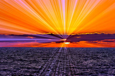 A Colorful Brilliant Set of Sun Rays Emanates from Behind then Clouds Foto de archivo