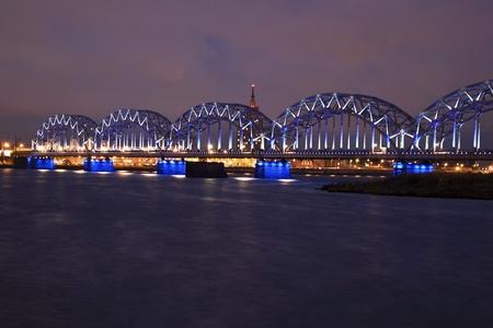 The railway bridge in Riga on the Daugava river, evening photo