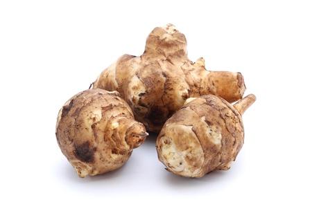 Three ripe topinamburs isolated on the white Stock Photo