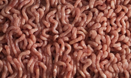 forcemeat: Raw pork forcemeat for the background Stock Photo