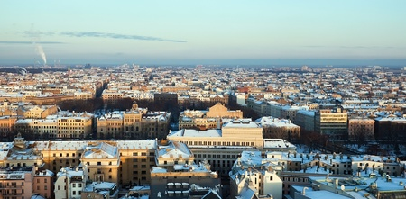 Aerial view of snow covered city Riga photo