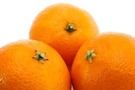 Three ripe  mandarins isolated on white background photo