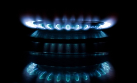 Blue gas flame on the black background photo